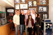 Team CRIMSON with the Legends Wall at Village Studios after a day of recording.